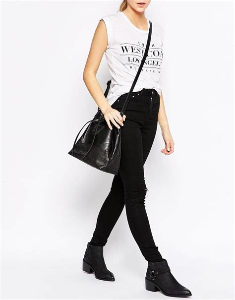 Asos Satchel In Black Leather urbancode with ostrich panel black satchel on tradesy