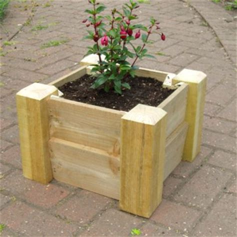 classic wooden planters raised beds