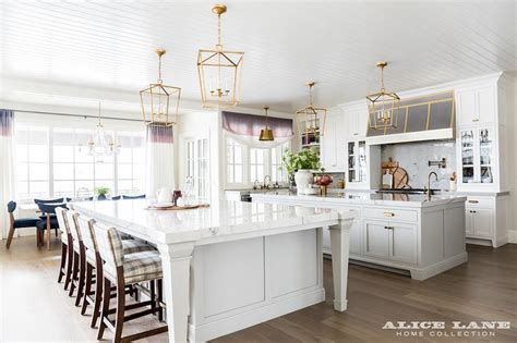 kitchen with 2 islands two kitchen islands unified with brass lanterns
