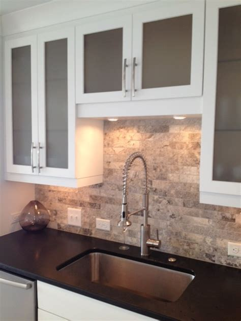 absolute black honed granite kitchen contemporary with marvelous travertine backsplash in spaces modern with