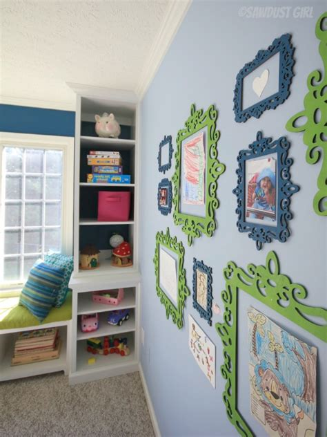 display art built in playroom window seat and storage cabinets