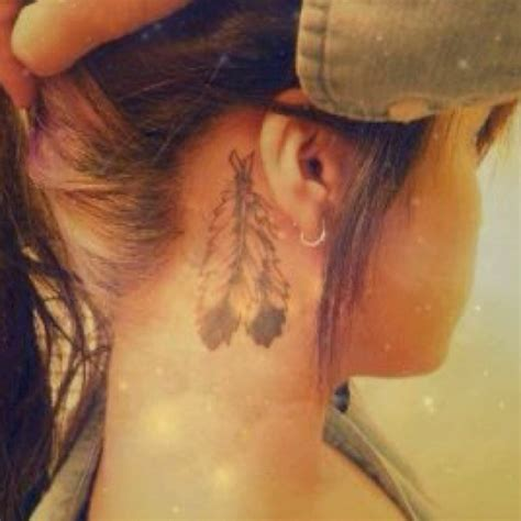 feather tattoo behind ear pinterest feathers behind ear tattoo tats piercings pinterest