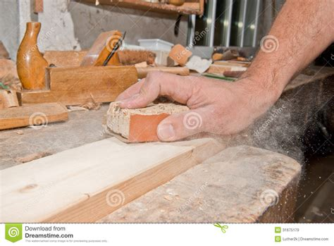 sanding detailed woodwork sanding wood royalty free stock images image 31675179
