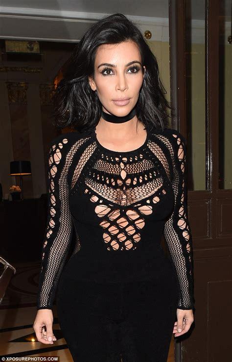 kim kardashian net jumpsuit daily mail kim kardashian gets the audience on their feet as she