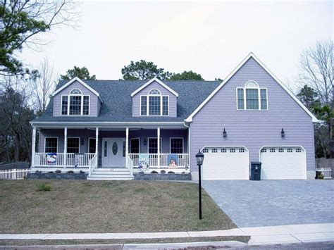 house plans with extra large garages cape cod style home with farmers porch two car garage and