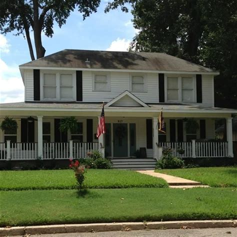 colonial style home with full front porch to relax and people watch on front porch lookin in
