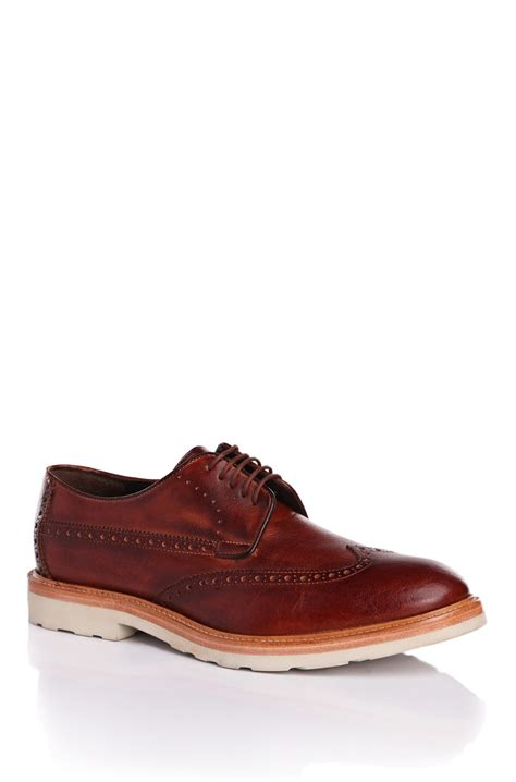 orange urdes leather derby wingtip shoes in brown