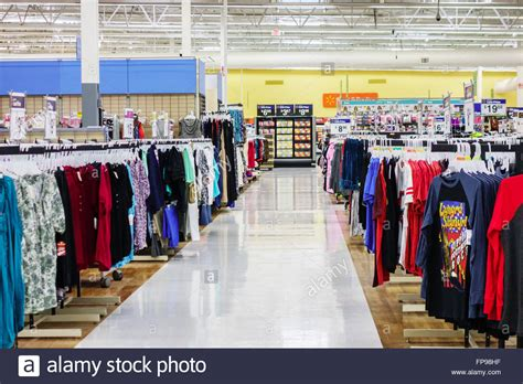 walmart interior showing a clothing lined aisle stock