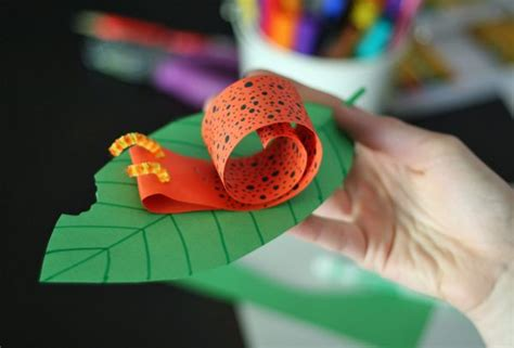Snail 311 Orange Riject coiled paper snail craft make and takes