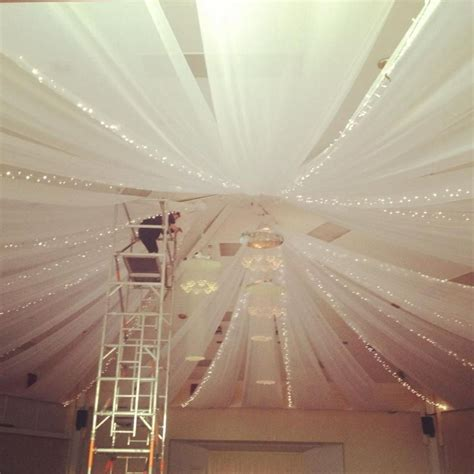 ceiling canopy with string lights venue dressing