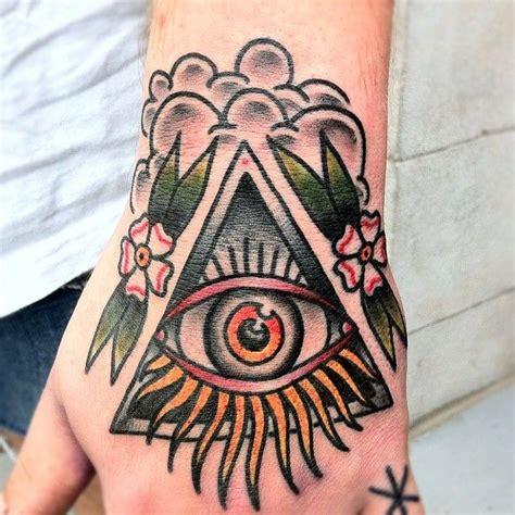 traditional tattoo hand eye traditional triangle eye tattoo on left hand by nick oaks