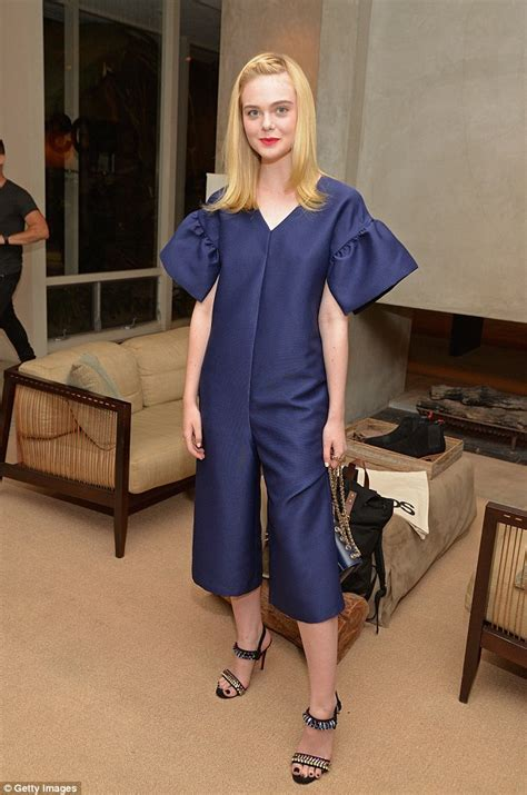 what is dakota fanning doing now fanning cuts a svelte figure in crop top and tennis