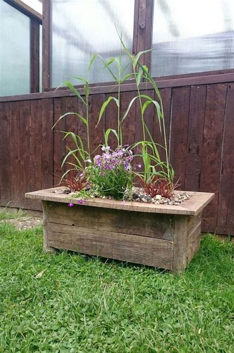 create a rustic log and pallet wood planter gardens