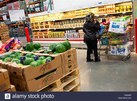 costco warehouse shopping customers shopping in the produce section of a costco wholesale stock photo royalty free image
