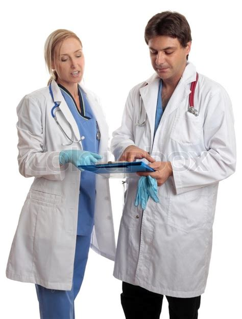 doctor and nurse surgeon and doctor or nurse read over and discuss a sick