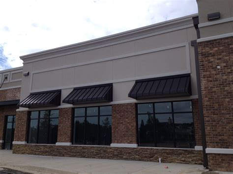 awnings for commercial buildings elite awnings 187 standing seam corrugated metal awnings