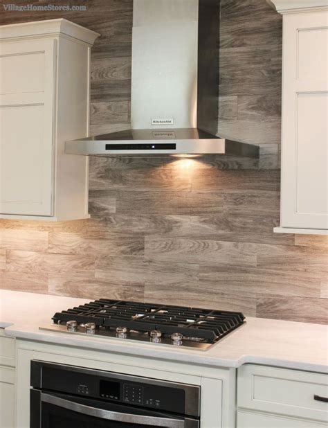 laminate kitchen backsplash porcelain floor tile with a gray woodgrain pattern is installed as a backsplash in this