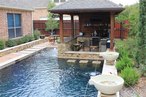 modern small backyard swimming pool with waterfall and water fountain for