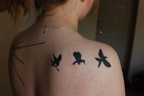 hunger games tattoos 20 and beautiful hunger tattoos
