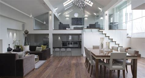 separation between kitchen and living room open floor plan living room kitchen dining room with glass wall separation vaulted ceiling