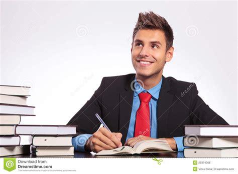 Man At Desk Thinking Writing Stock Photo Image 29374368 At Desk
