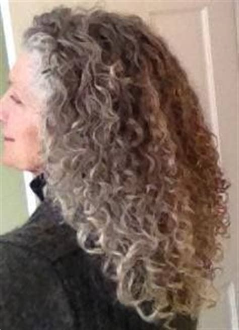 knee length salt and pepper hair curly longer gray hair women who rock the silver hair