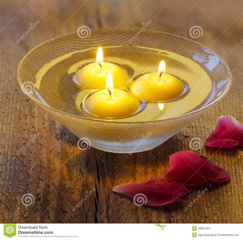 floating paper boat with candle floating candles and paper boat in bowl of water stock