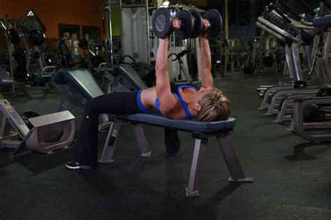 women bench pressing dumbbell bench press exercise guide and video