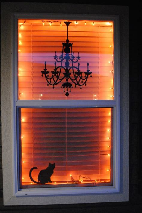 35 Ideas To Decorate Windows With Silhouettes On Halloween Lights Window Decorations