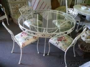 Vintage wrought iron patio table amp chairs currently painted bronze