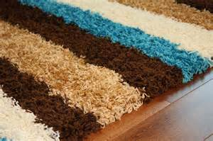 shaggy rug teal blue chocolate brown striped mat