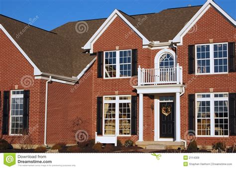 brick two story home stock image image of mortgage blue