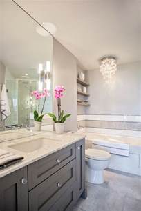 and grey bathroom features ceiling height frameless mirror over tiles pinterest gray bathrooms dark