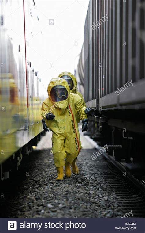 There Was A Disaster At Work On 2 by Firemen Wearing Hazmat Suits At Work During A Disaster