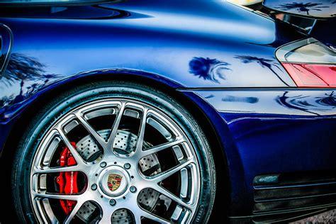 porsche wheel emblem porsche wheel emblem 1329c photograph by reger