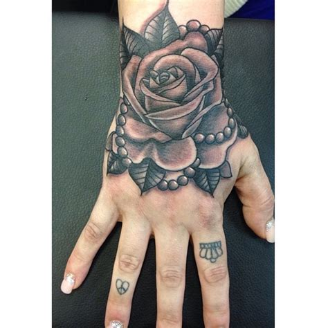 laurakennedytattoo doing this rose with pearls on the