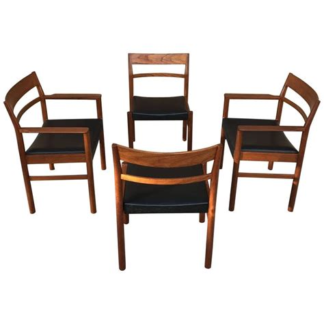 set of four modern teak dining chairs by kurt