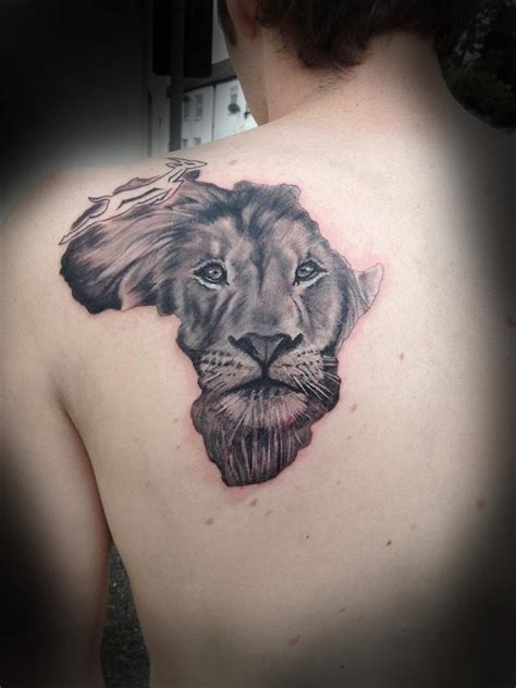 lion face in african map tattoo design back shoulder