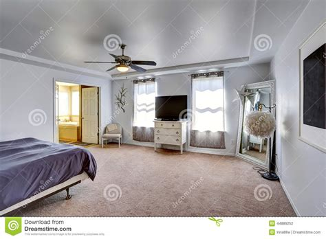 5 Bedroom 3 Bathroom House Plans master bedroom with tv and large mirror in the corner