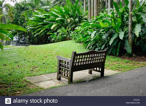 outdoor bench singapore a wooden bench at botanic garden in singapore singapore