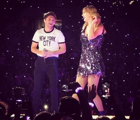 taylor swift and niall horan taylor swift brings out niall horan robbie williams for
