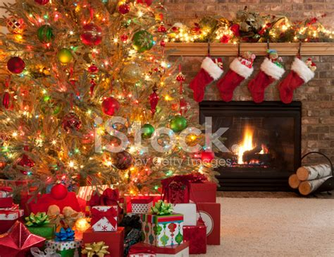 christmas tree in front of fireplace stock photos