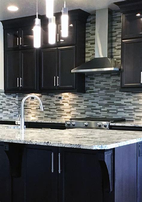 gorgeous customer kitchen featuring dark cabinets  clean