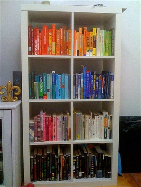 color coordinated bookshelf before and after a color coordinated bookcase popsugar home