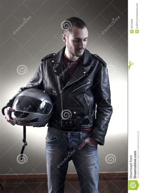 biker leather biker in leather jacket and helmet stock photo image 45274693