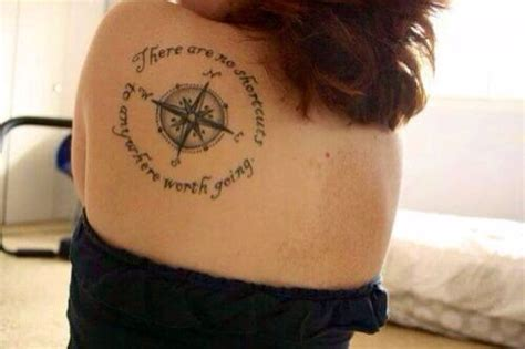 compass tattoo phrase girl with a compass tattoo with words on back of her
