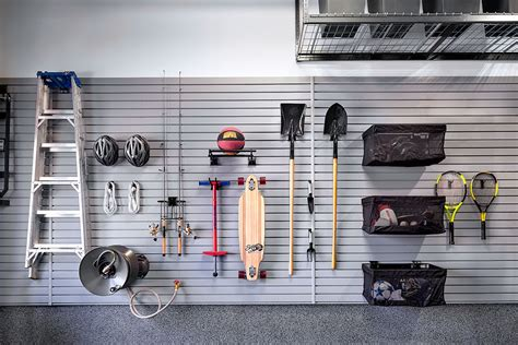 Garage Organization Wall Systems reclaim your garage floor space using a slatwall system