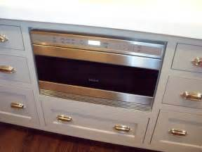 kitchen with wolf microwave drawer built into island