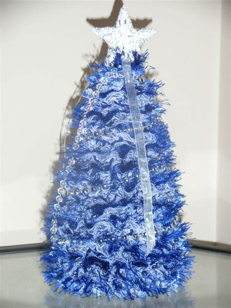 knitted xmas tree with blue eyelet lace christmas tree