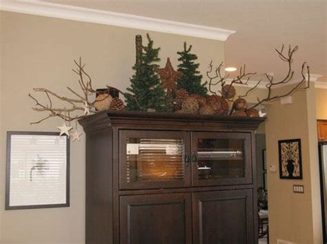 christmas decorations on top of cabinet kitchen pinterest